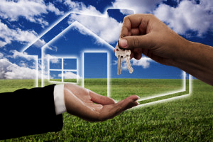 Handing Over Keys on Ghosted Home Icon, Grass Field, Clouds and Sky.